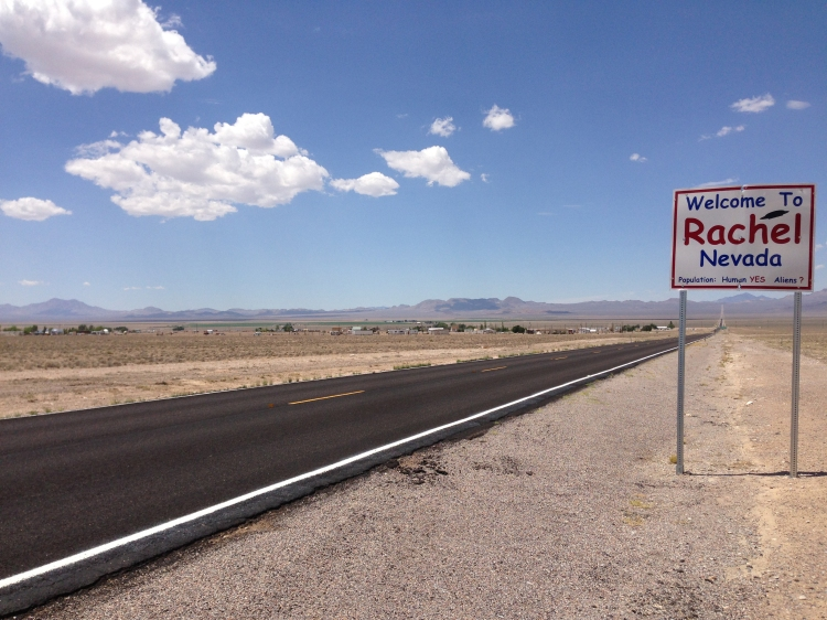2014-07-18_13_11_09_sign_for_and_view_of_rachel2c_nevada_from_northbound_nevada_state_route_375_about_38.5_miles_north_of_nevada_state_route_318
